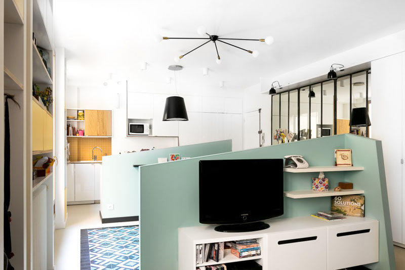 Pony Walls Break Up The Living Room Dining And Kitchen In This Tiny Apartment