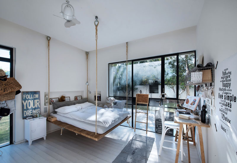14 Inspirational Bedroom Ideas For Teenagers // A suspended bed and a neutral pallet in this teen bedroom makes for an inspiring space that can easily be changed as tastes come and go.