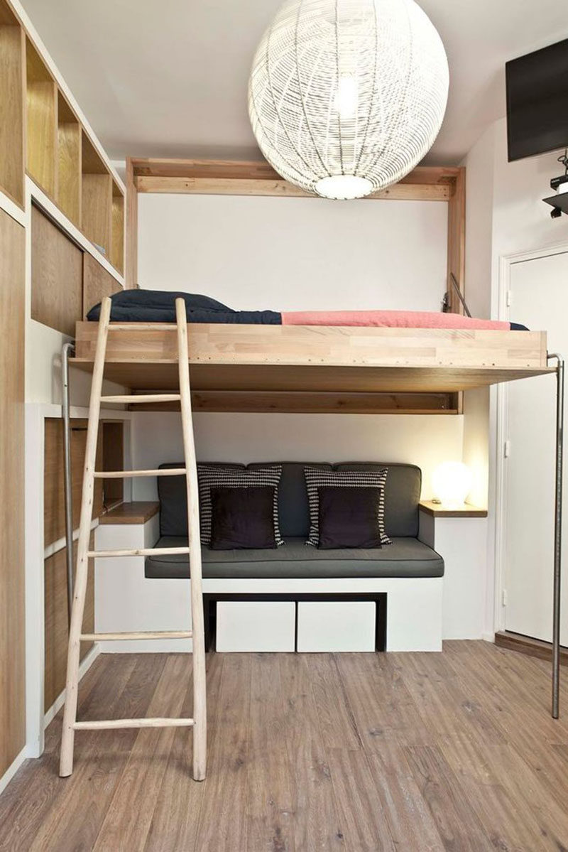 14 Inspirational Bedroom Ideas For Teenagers // Loft beds don't just have to go above desks - they can over pretty much anything, as seen in this bedroom where the bed sits above a seating area and can be folded into the wall when not in use.