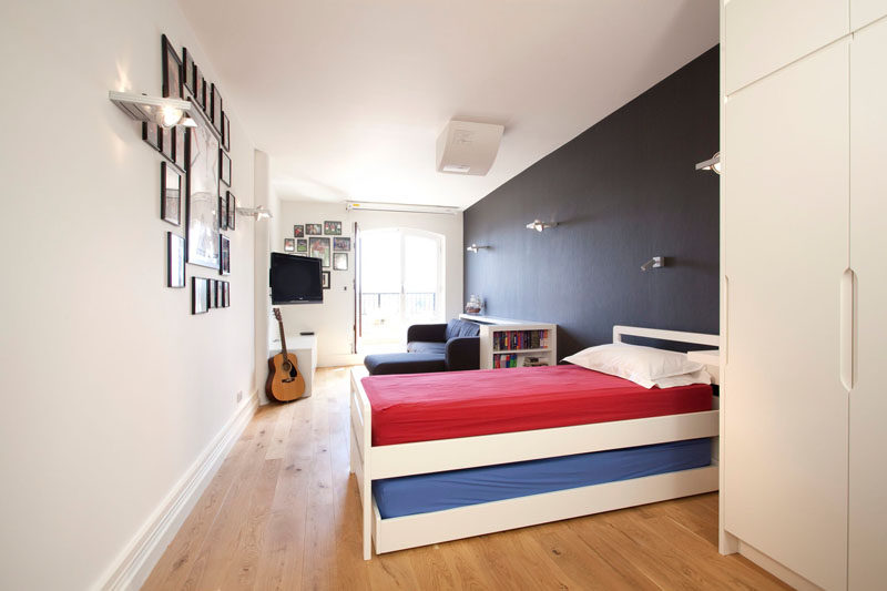 14 Inspirational Bedroom Ideas For Teenagers // This bedroom provides lots of space for relaxing, reading, and music playing and keeps a pull out bed nearby, perfect for sleepovers.