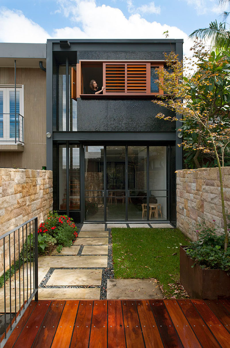 A bold black and wood exterior was given to this terrace for Terrace of the house