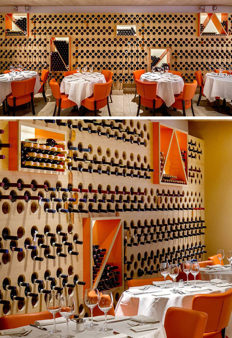 A restaurant accent wall was created by turning it into wine storage.