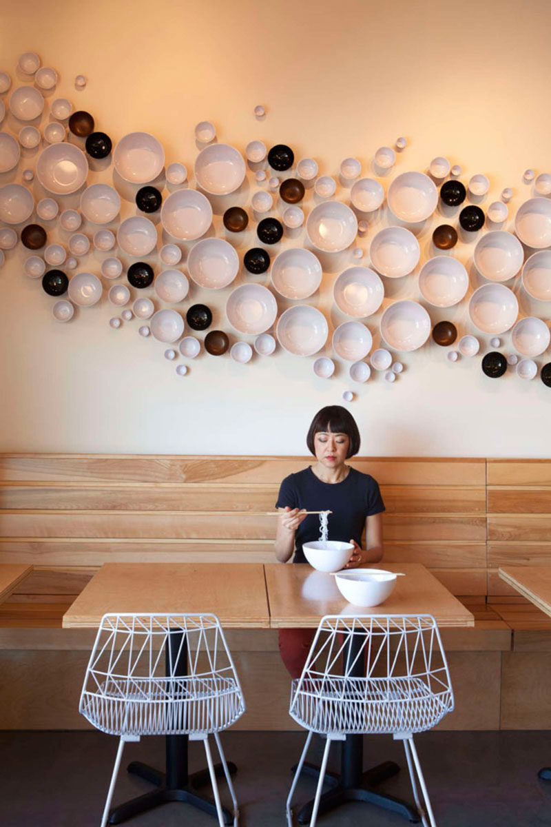 This Asian-American fusion restaurant has bowls installed on the wall to create a unique accent.