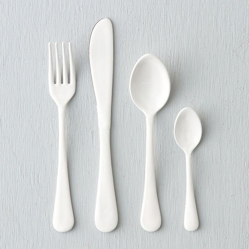 Throw An All White Party With These Ideas For Food And Decorations / Include modern white flatware when setting your table.