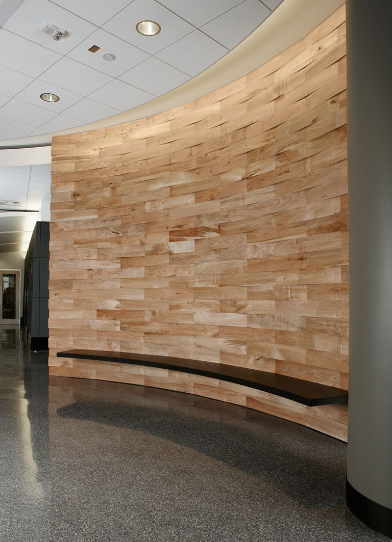 Accent Wall Ideas - 12 Different Ways To Cover Your Walls In Wood // Salvaged and cleaned wood makes up the body of this curved accent wall in a commercial space.
