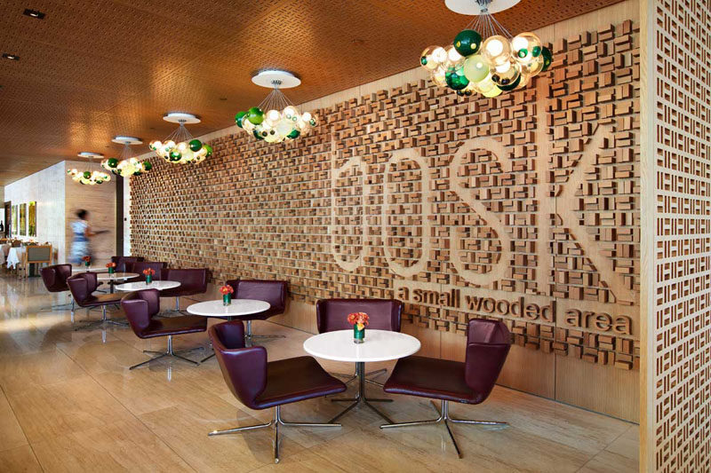 Accent Wall Ideas - 12 Different Ways To Cover Your Walls In Wood // Wood blocks have been arranged on this wall to create a textured look and spell out the name of the restaurant in an original way.