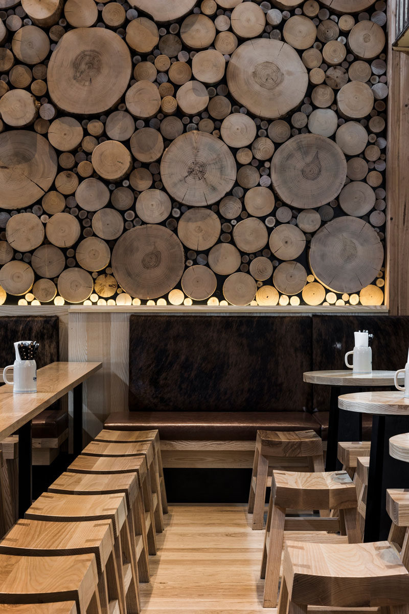 Accent Wall Ideas - 12 Different Ways To Cover Your Walls In Wood // The cross sections of tree stumps displayed on this wall bring in warmth and mimic the natural look of a forest floor.  #AccentWall #FeatureWall #WoodAccentWall #WoodFeatureWall #InteriorDesign