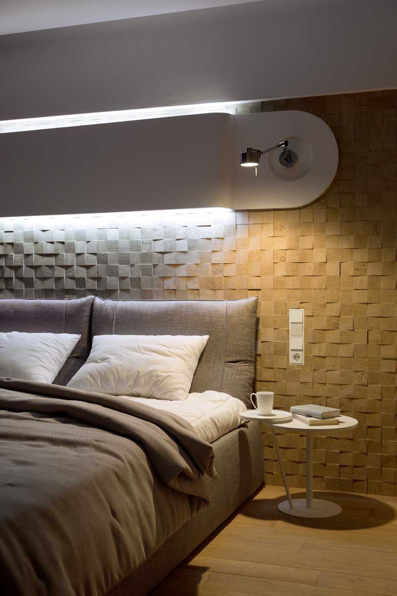 Accent Wall Ideas - 12 Different Ways To Cover Your Walls In Wood // Slightly uneven wood blocks with their grains arranged in random order, add texture and coziness to this bedroom.  #AccentWall #FeatureWall #WoodAccentWall #WoodFeatureWall #InteriorDesign