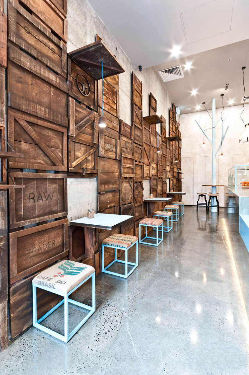Stained Wood Crates Have Been Dismantled And Reembled On This Wall Creating A Rustic Yet Contemporary Feel In The E