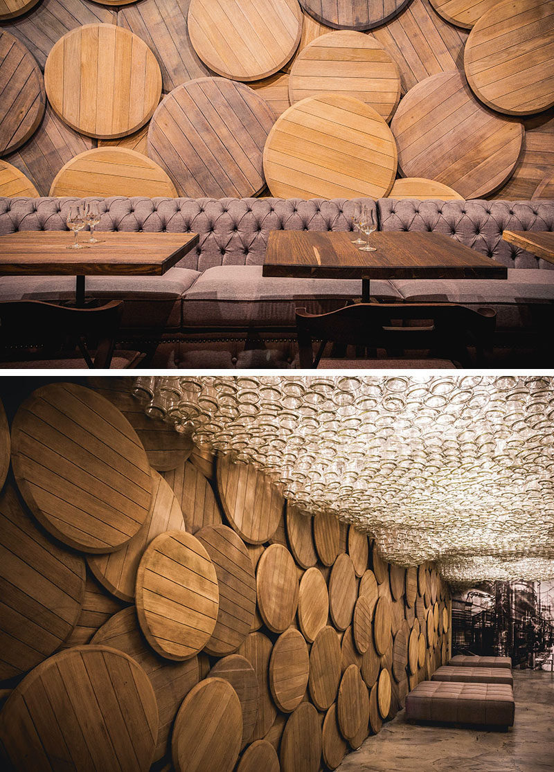 Accent Wall Ideas - 12 Different Ways To Cover Your Walls In Wood // Wood brandy barrels line the wall of this brandy bar in Odessa, Ukraine.