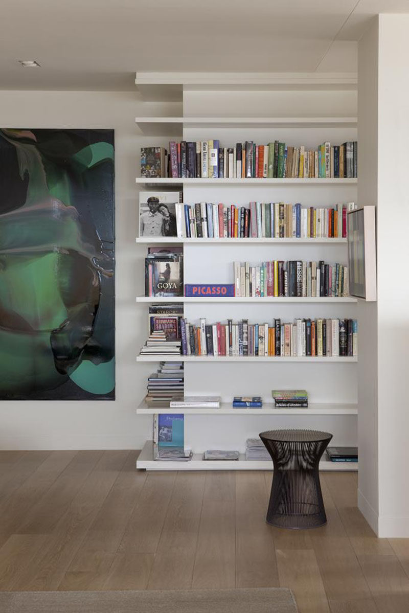 SHELVING IDEA - Shelves That Wrap Around Corners // Shelves wrapping the corner of these walls make efficient use of a potentially awkwardly placed wall.