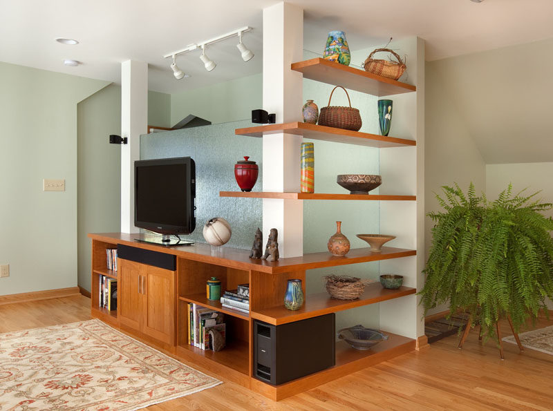 SHELVING IDEA - Shelves That Wrap Around Corners // Wrap around shelves in this entertainment area provide space to display treasures and favorite possessions.