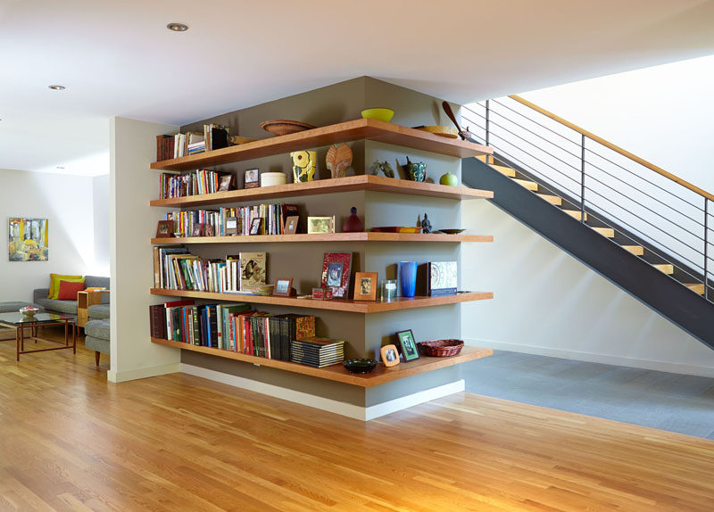 SHELVING IDEA - Shelves That Wrap Around Corners // Books have been confined to one side while decor pieces are displayed on the other side of this wrap around shelving installation.