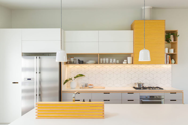 Palette Profile - Yellow, Gray and White Interiors // White countertops and cabinetry, along with gray drawers and silver appliances let the yellow details pop out but keep them from being too much.