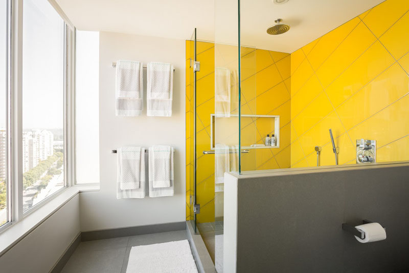 Palette Profile - Yellow, Gray and White Interiors // Surrounded by white walls and gray flooring, the yellow tiles are confined to the shower to prevent the color from completely dominating the space.