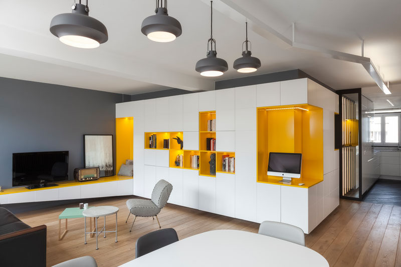 Palette Profile - Yellow, Gray and White Interiors // Gray walls, white cabinetry, and a few fun splashes of yellow bring life and personality into this Parisian home.