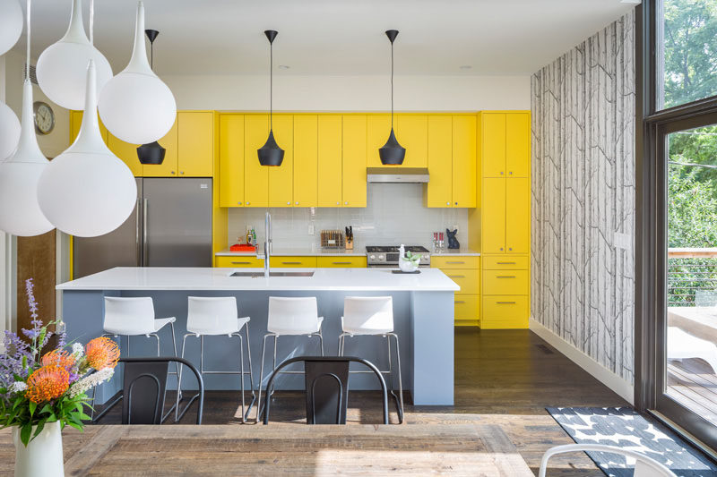 Palette Profile - Yellow, Gray and White Interiors // Bright yellow cupboards make a bold statement in this kitchen sprinkled with white and grays to keep the yellow from being overwhelming.
