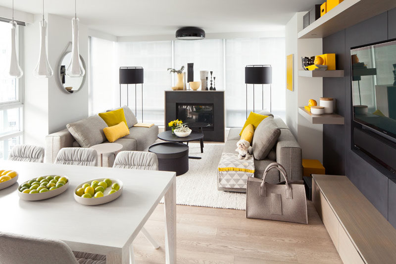 Yellow Accents Used Throughout The Living Areas In This Home Add Life To  The Otherwise All Black, White, And Gray Interior.