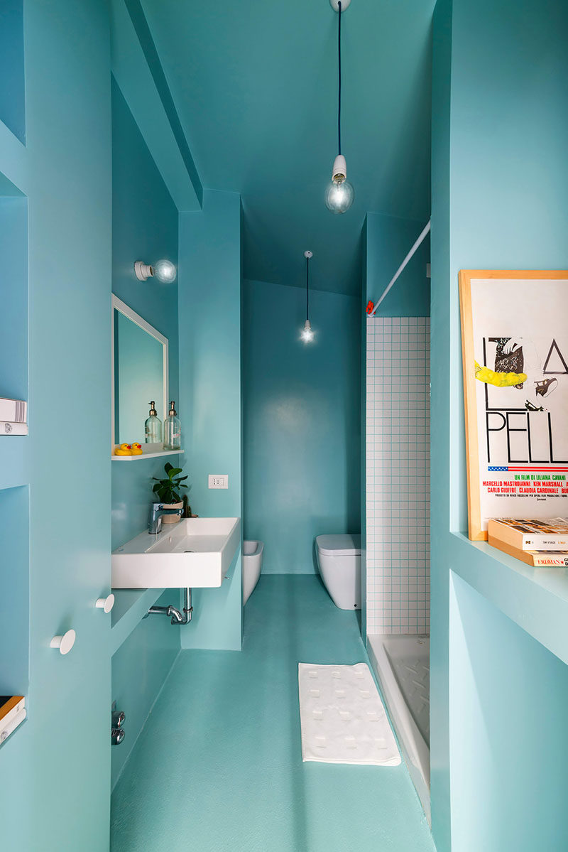 13 Inspirational Examples Of Blue And White Bathrooms // The commitment to the blue and white theme is evident in this bathroom that used blue grout between the white tiles in the shower.