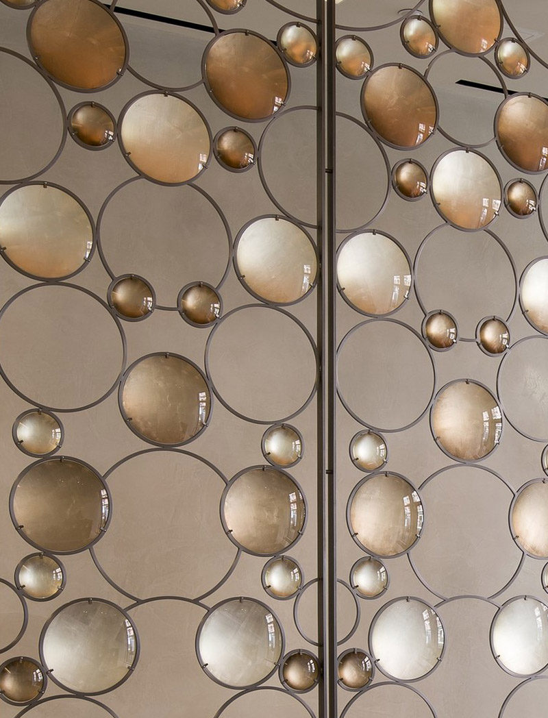 Room Divider Idea - Artist Christophe Côme created a 'Bubble Screen', made from iron, industrial crystal and molded glass lenses, that is art and also functions as a room divider in the lobby of a New York building.