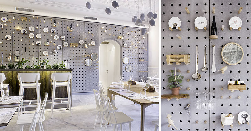 Wall Decor Idea - A gray perforated concrete pegboard lines the wall of this cafe for a unique shelving solution.