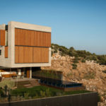 This home of concrete and wood overlooks the Aegean Sea