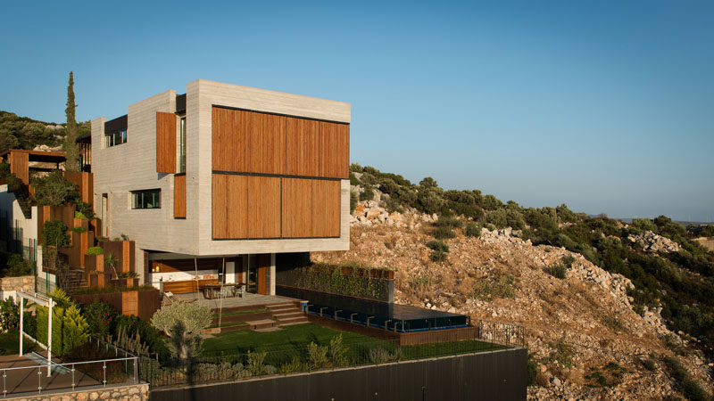 Located on a steep slope in Çesme, Turkey, is this home that has a huge section that cantilevers out 26 feet (8 meters), providing a dramatic look for the design.