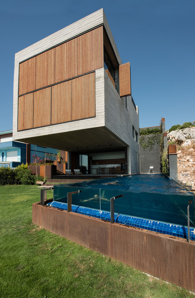 Located on a steep slope in Çesme, Turkey, is this home that has a huge section that cantilevers out 26 feet (8 meters), providing shade for the backyard and swimming pool.