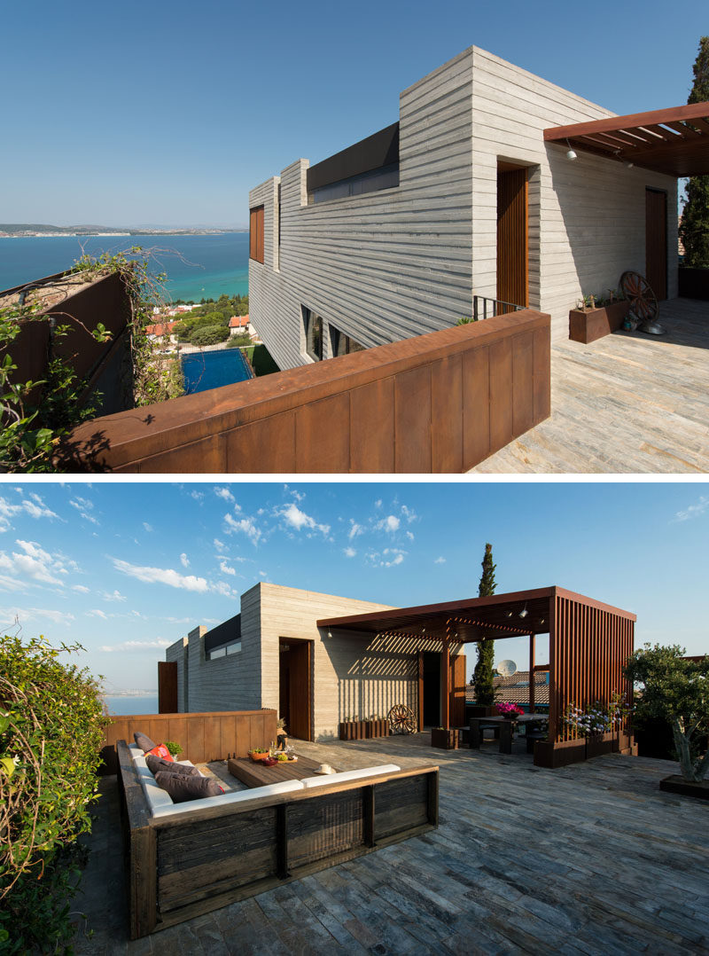 At the top of this home, there's an outdoor area with a covered dining space, and a lounge that takes advantage of the view.