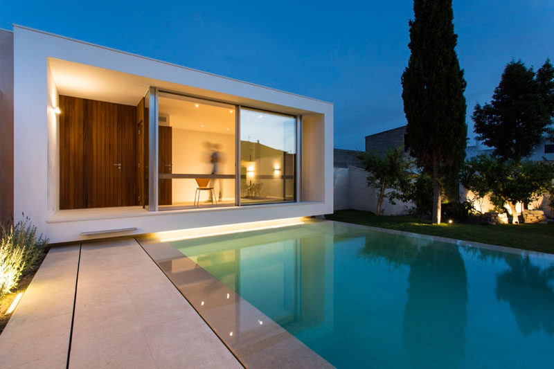 A Home Office Overlooking Swimming Pool Was Designed For This House Spain