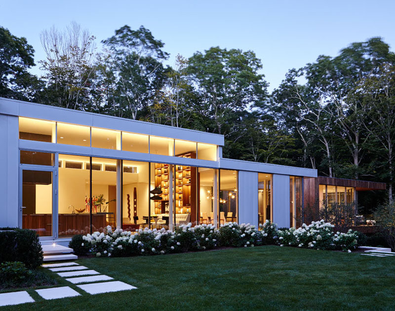 A landscaped yard with paths surrounds this New York home.