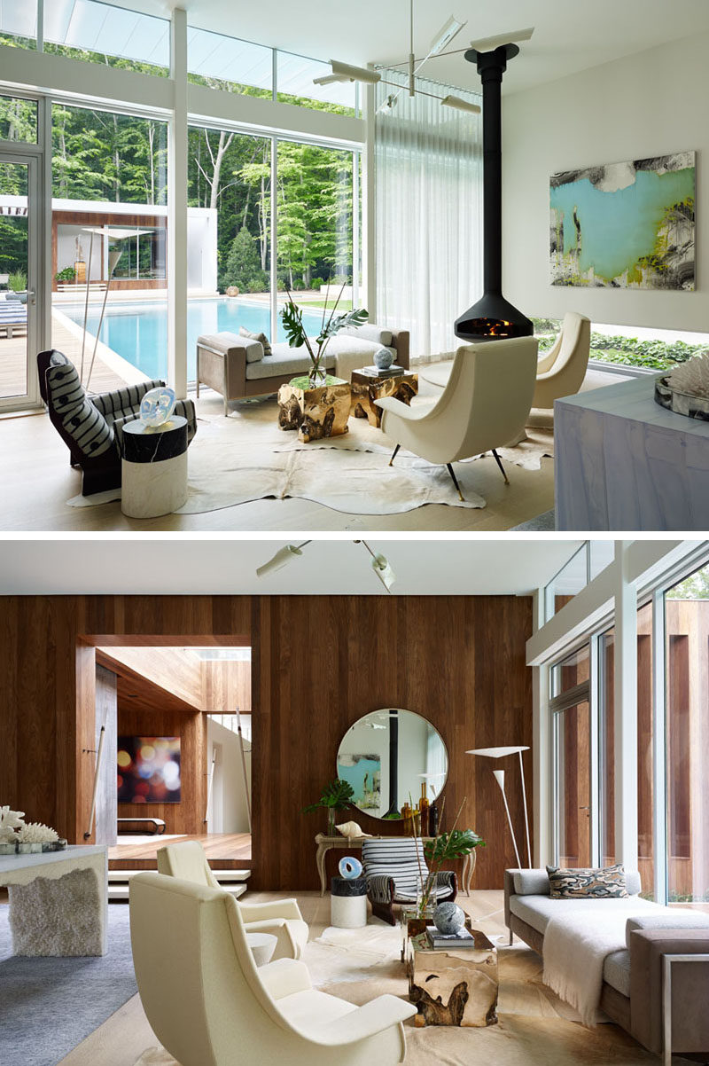 With views of the pool outside, this sitting area has a hanging fireplace to keep it warm on cool nights.