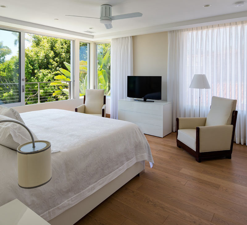 Lots of light enters this bedroom from the large floor-to-ceiling windows and private balcony.