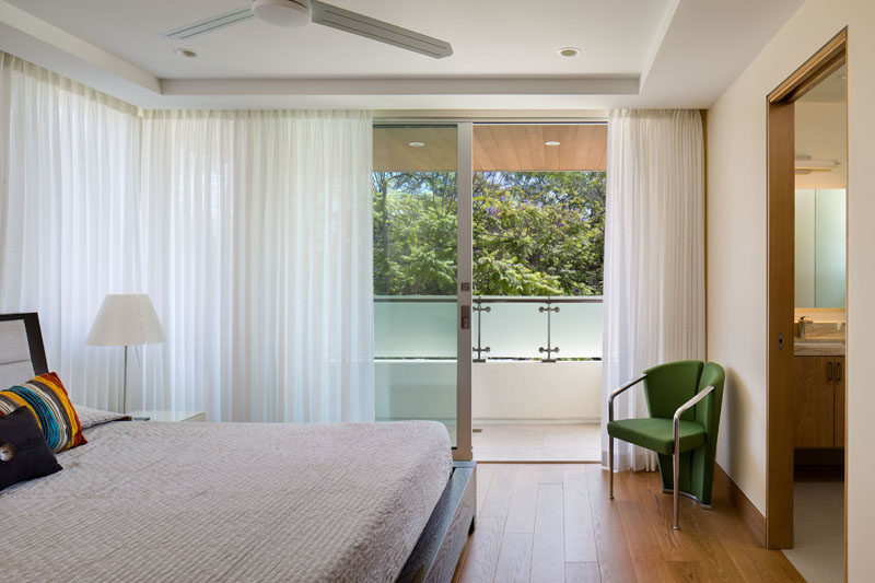 This bedroom has an ensuite bathroom and a private balcony.