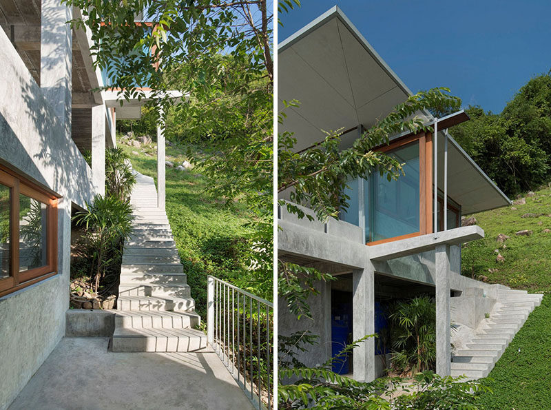 Outdoor concrete stairs lead you between the different levels of this home.