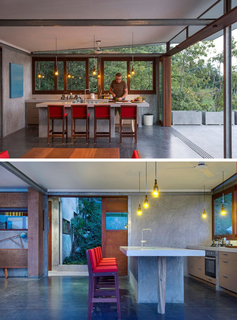 In this kitchen there's no overhead cupboards or tall fridge, keeping the space simple, and bottles have been transformed into pendant lights.