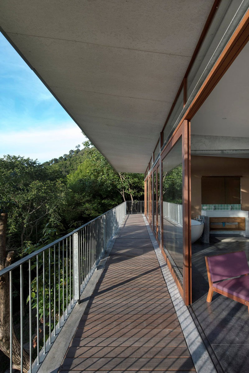 A long balcony provides access to the bedrooms of this home.
