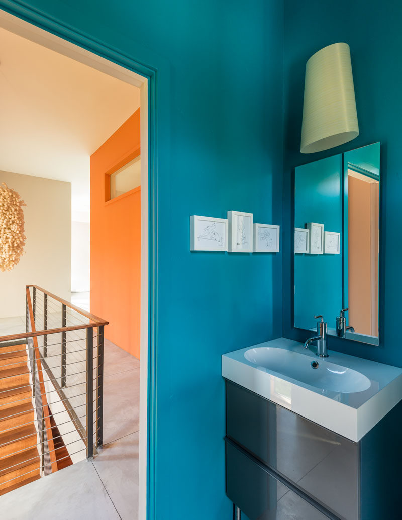 This bathroom is full of energy with its bright blue walls.