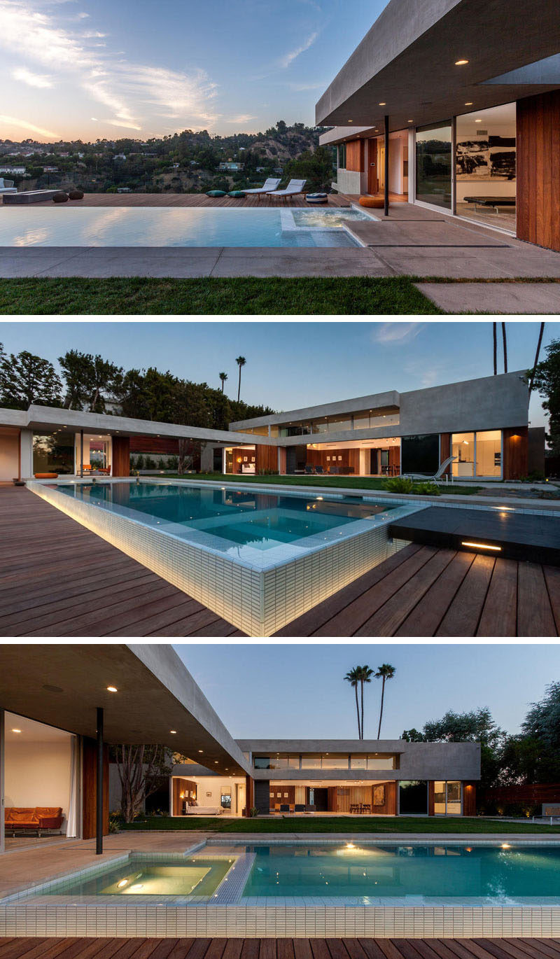 This backyard features a swimming pool with outdoor lounge areas. At night, the swimming pool and backyard are highlighted with lighting, perfect for evening entertaining.