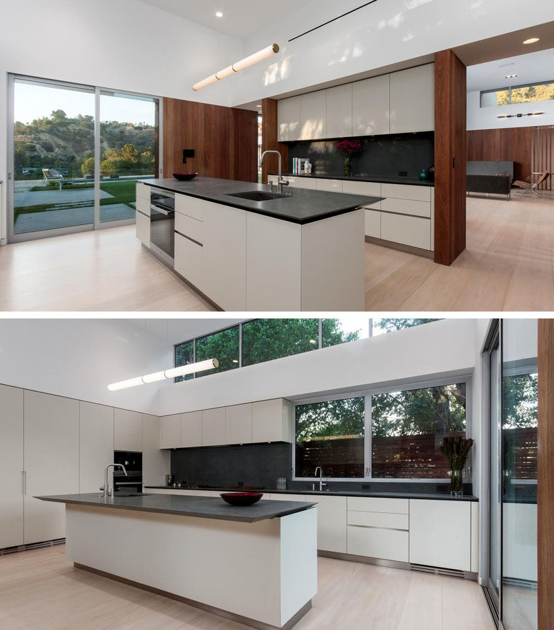 This kitchen has plenty of storage and a centrally located island, as well as access to the backyard through a sliding door.