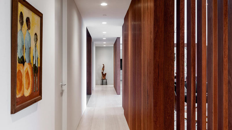 Wooden partitions help to define the hallway in this home.