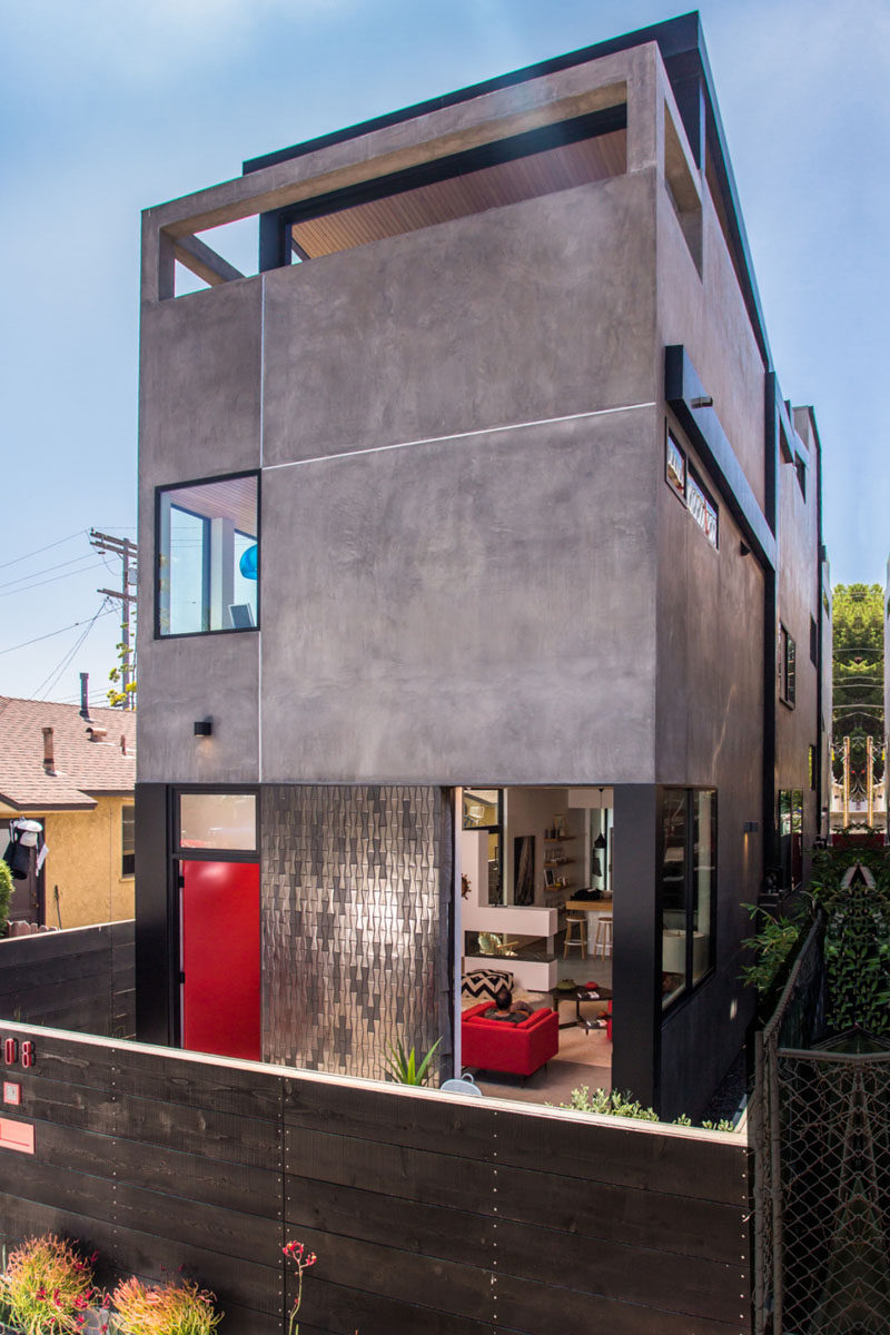 a new home clad in dark stucco and tile arrives in los angeles
