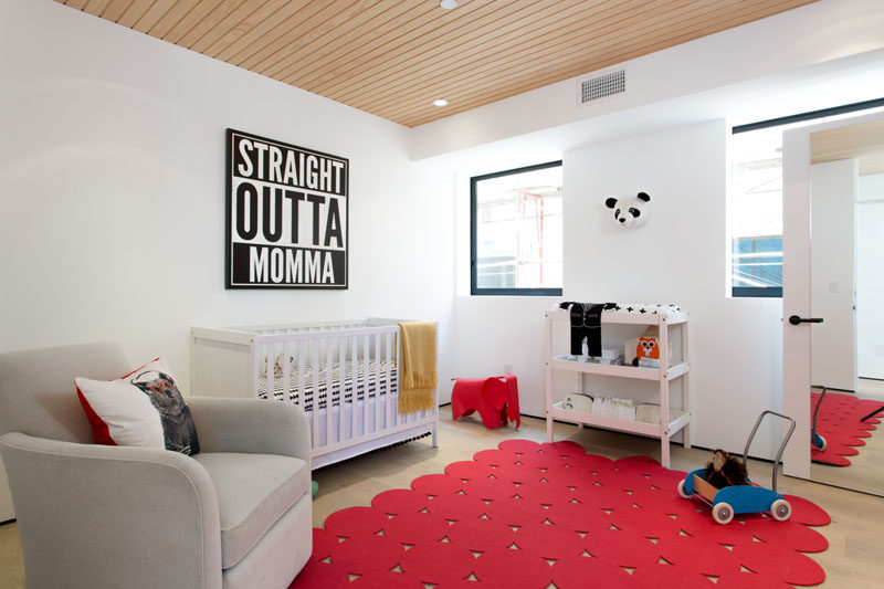 Pops of red paired with fun artwork make this nursery feel fun and colorful.
