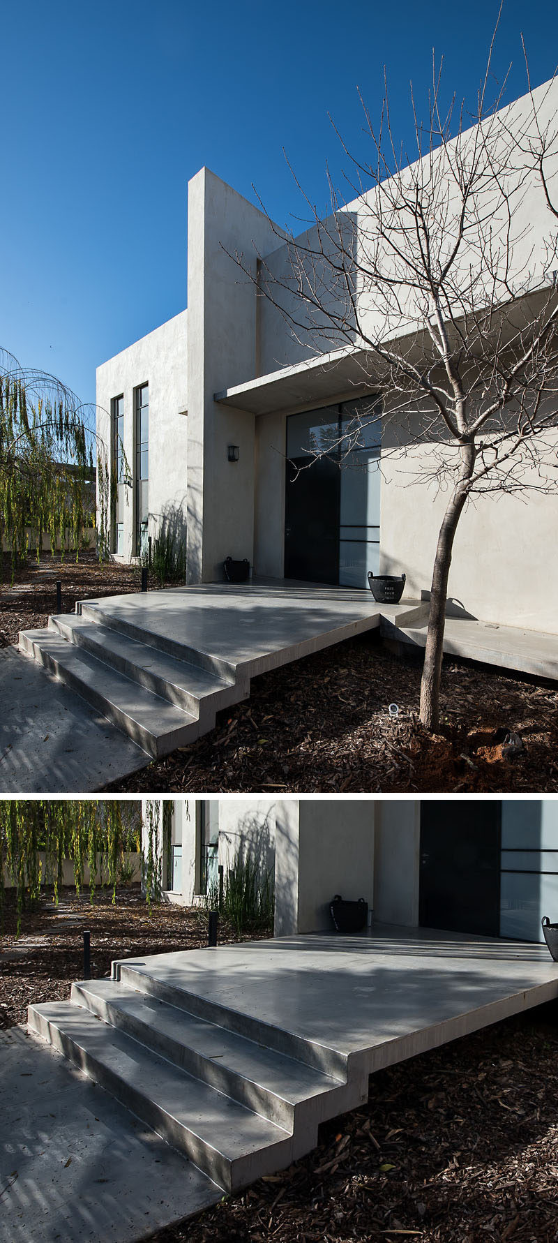 At the front of this home, tree bark covers the ground to enhance the concrete strip and stairs leading you to the front door.