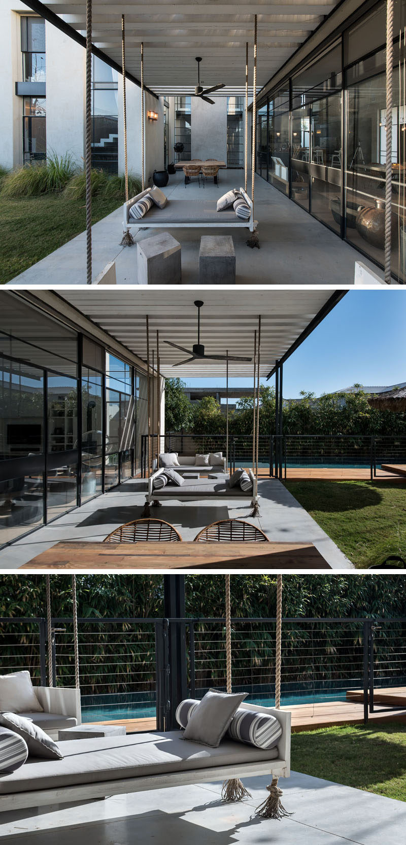 This covered patio is home to a couple of swing benches and an outdoor dining table.
