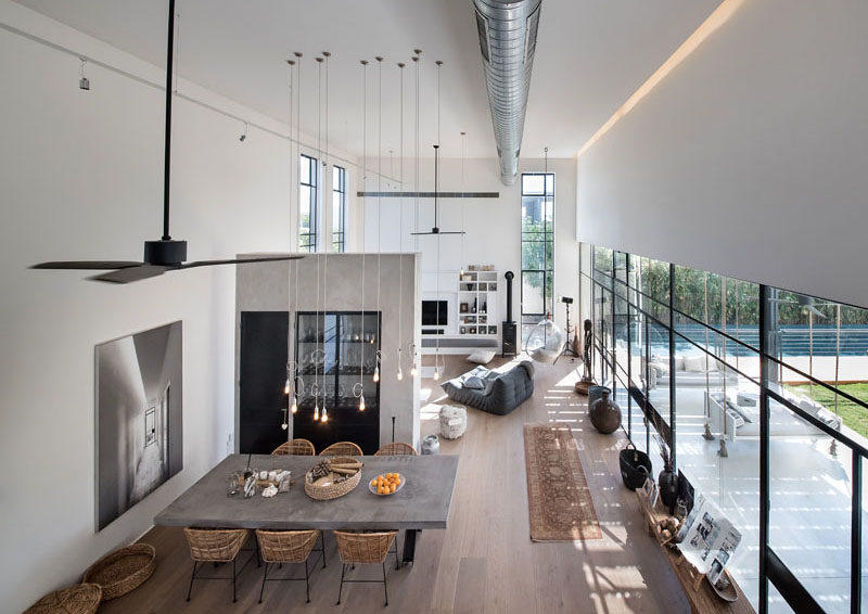 In this house, the living area is separated from the dining area by a partial wall that has storage hidden inside.