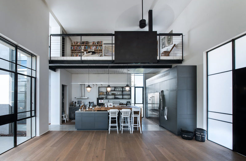 This home has a lofted reading space located directly above the kitchen.