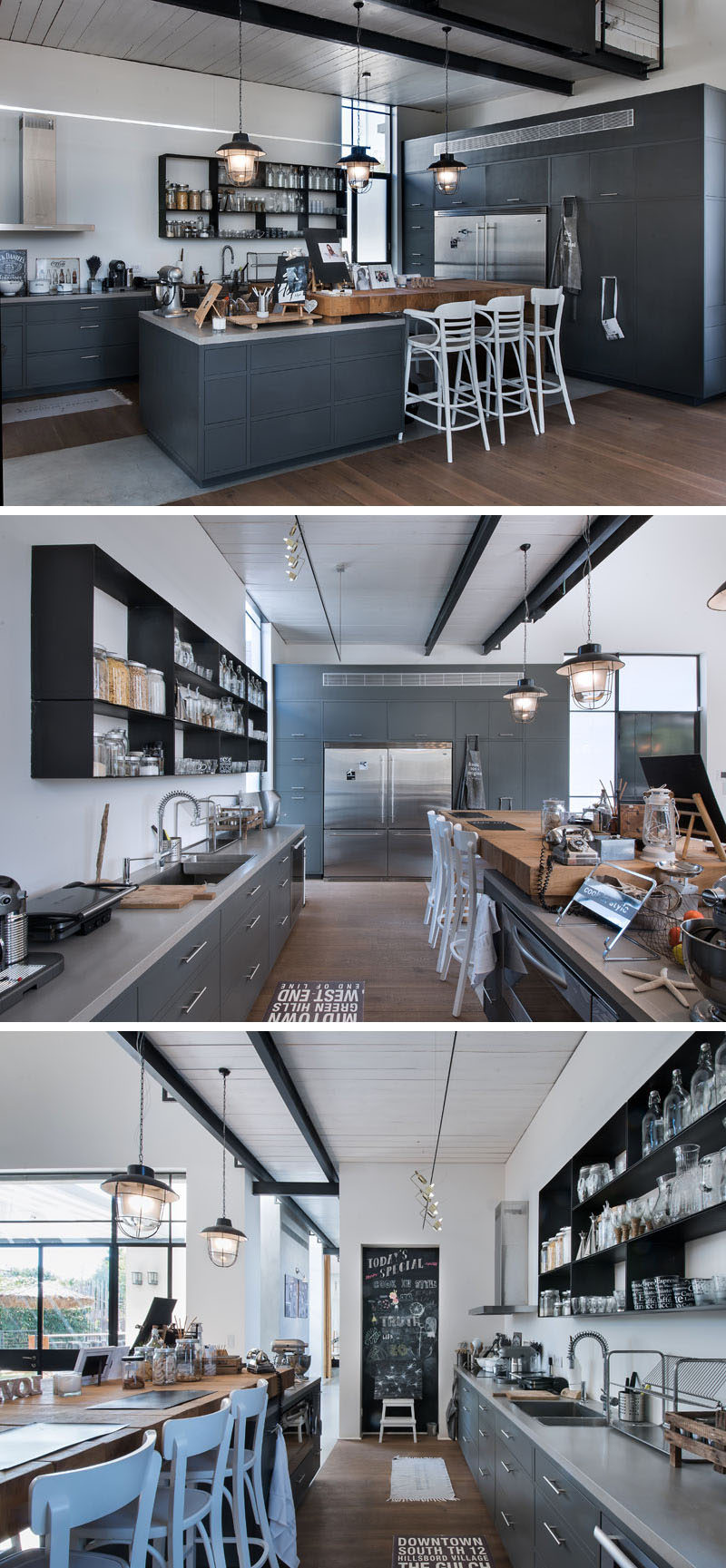 In this kitchen, the central island has a large wooden butcher block top, and white accents, like the chairs, pop against the dark gray cabinets.