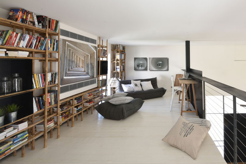 This home has a lofted reading space with bamboo shelving.