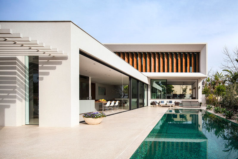 Paz Gersh Architects have designed this contemporary L-shaped home in Tel Aviv, Israel, for a family with children.